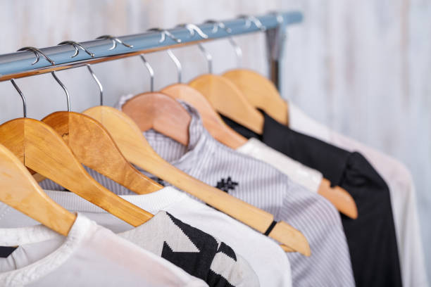 black and white womens clothes on hangers on rack in fashion sto stock photo