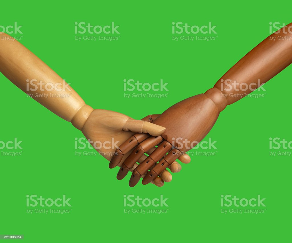 Black and white wooden hand holding each other stock photo