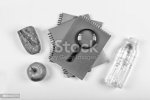 istock black and white.Back to school concept. school snack. lunchbox, stationery, Free space for text. Copy space. 965444274