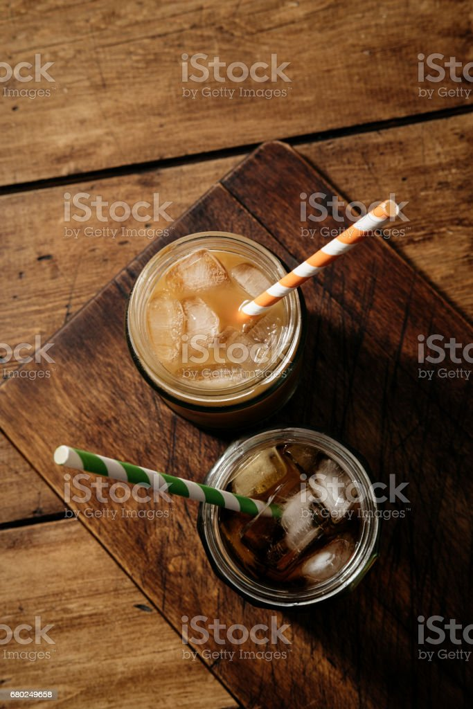 Black and with mild Iced Cold brew Coffee from above. stock photo