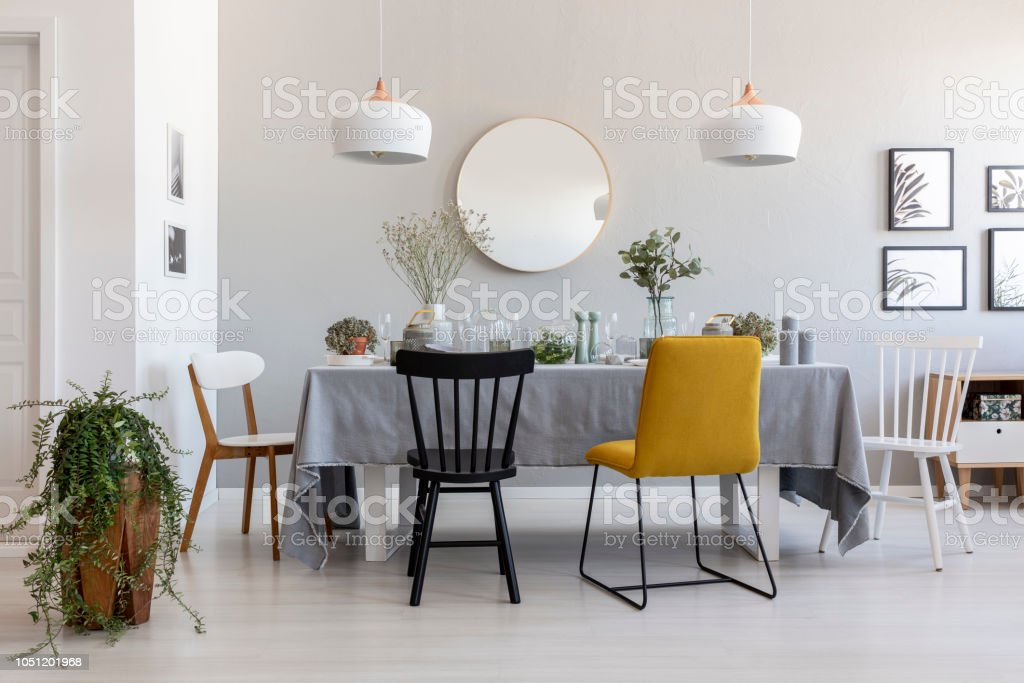 Black And Yellow Chair At Table In White Dining Room Interior With Plants Lamps And Mirror Real Photo Stock Photo Download Image Now Istock