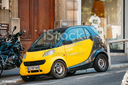 Marseille, France  - June 30, 2015: Black and yellow colors Smart Fortwo coupe on street