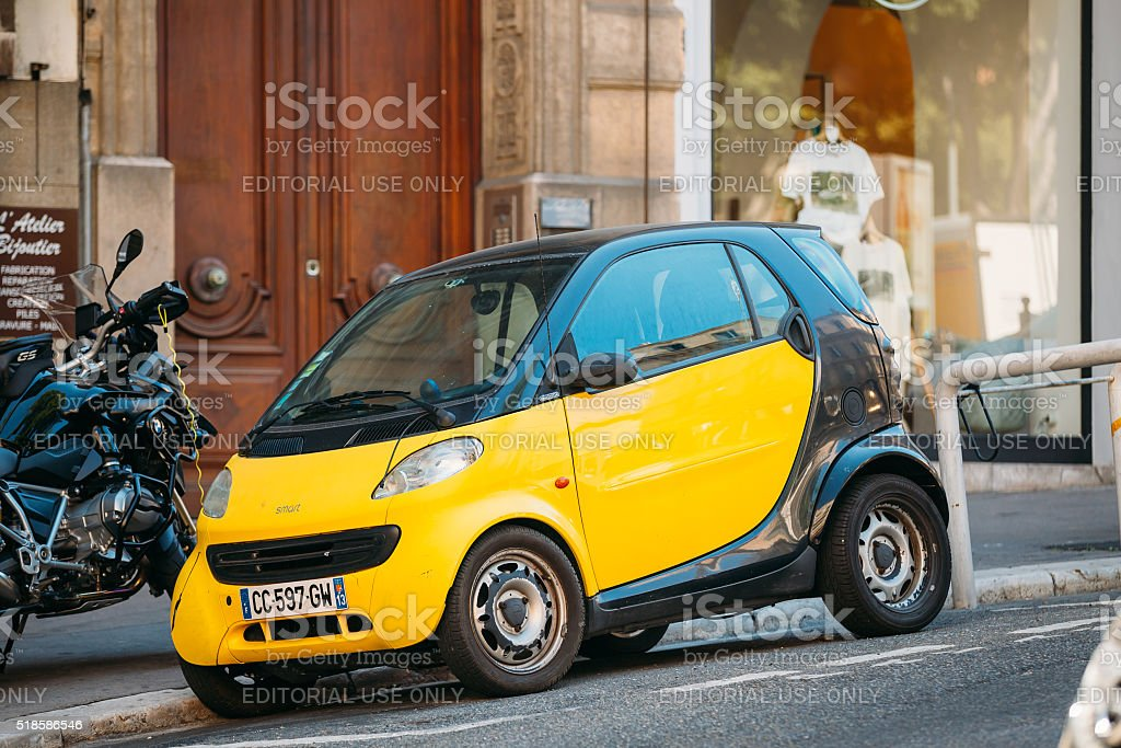Black and yellow colors Smart Fortwo coupe on street stock photo