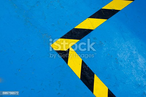istock Black and yellow glossy barrier tapes - Security strip 599756572