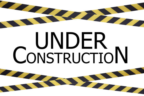 black and yellow lines of barrier tape with under construction title - under construction icon foto e immagini stock