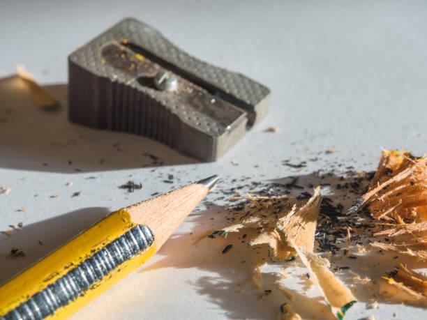 black and yellow pencil and metal sharpener - foto stock