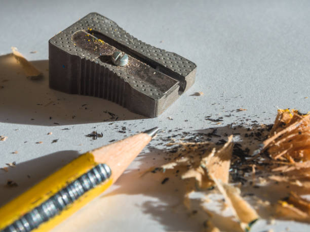 black and yellow pencil and metal sharpener - foto stock