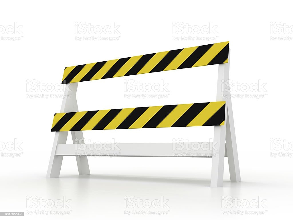 A black and yellow striped barrier stock photo