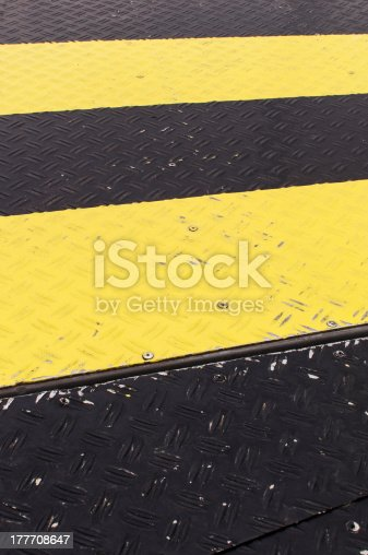 97709303 istock photo Black and yellow stripes 177708647