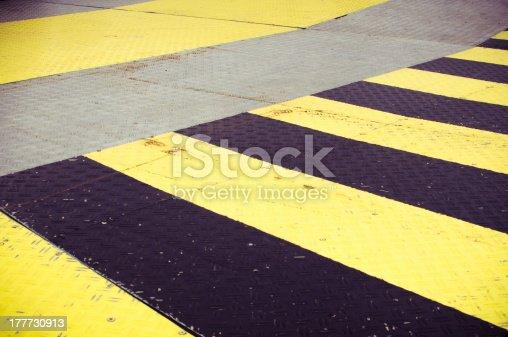97709303 istock photo Black and yellow stripes 177730913