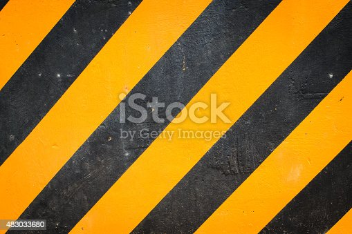 istock Black and yellow warning background 483033680