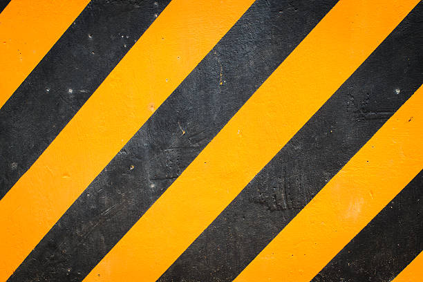Black and yellow warning background stock photo