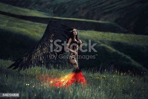 istock Black Angel. Pretty girl-demon 546204808