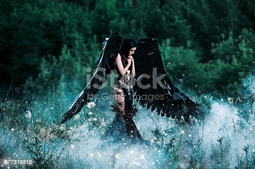 istock Black Angel. Pretty girl-demon 577318816