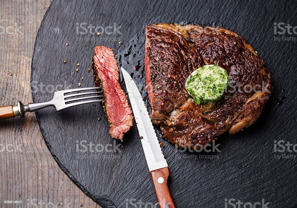 Black Angus Steak Ribeye with herb butter stock photo