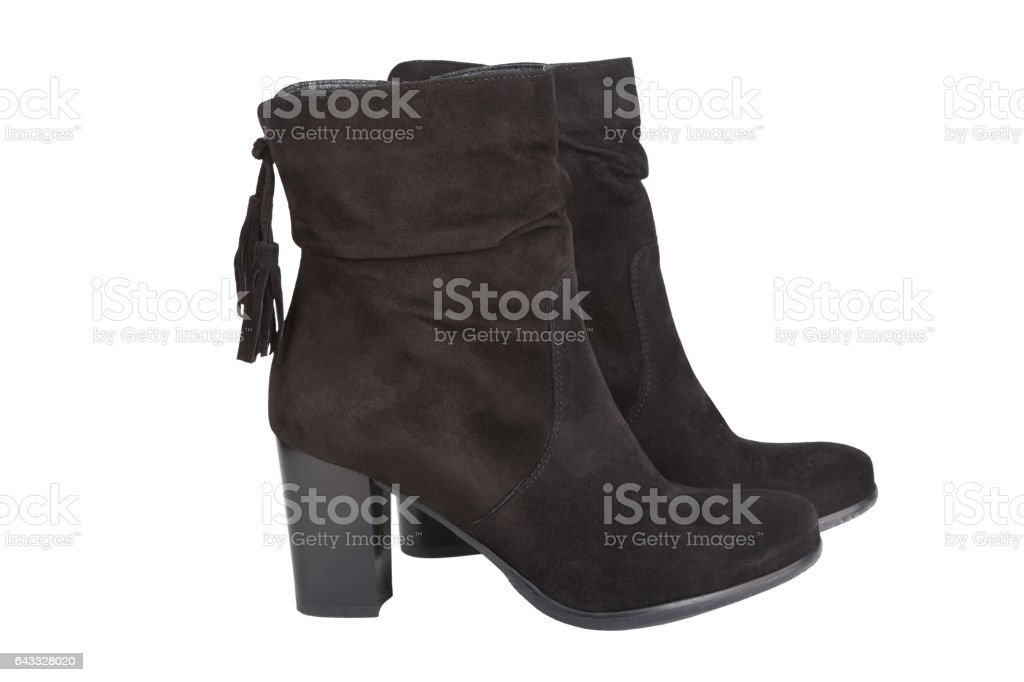 Black ankle boots with a tassel isolated on white - Photo