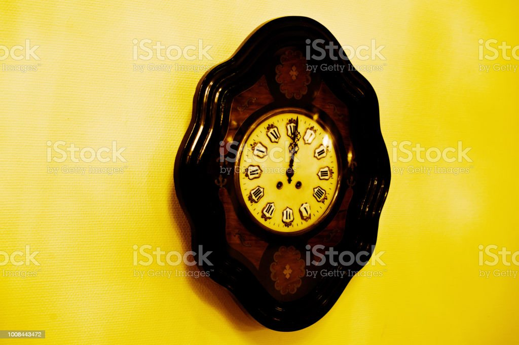 A Black Antique Clock On Wall