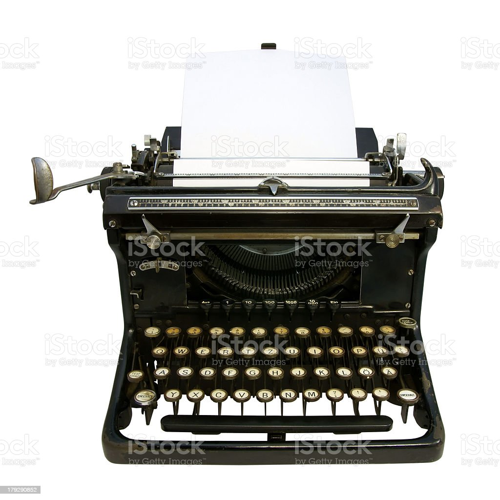 A black, antique typewriter with blank papers royalty-free stock photo