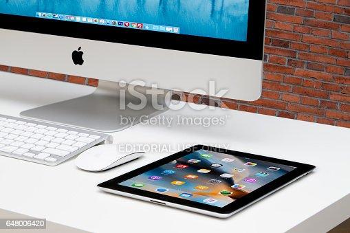TURKEY, Mersin JANUARY 19, 2017: Black Apple Tablet iPad on white table near APPLE IMAC monitor, keyboard and mouse.