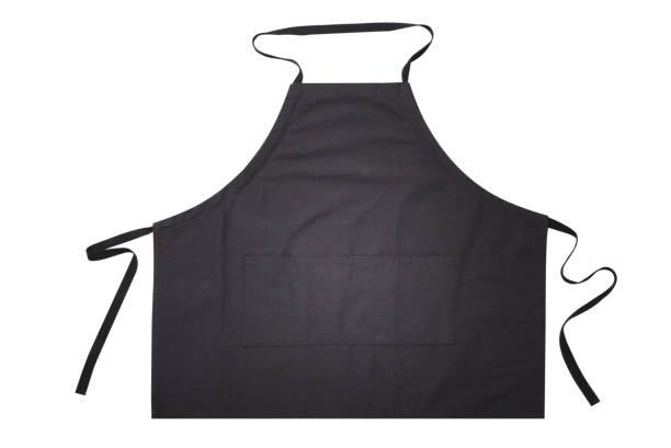 Delantal negro para la vista superior de la cocina. Aislado sobre fondo blanco. - foto de stock