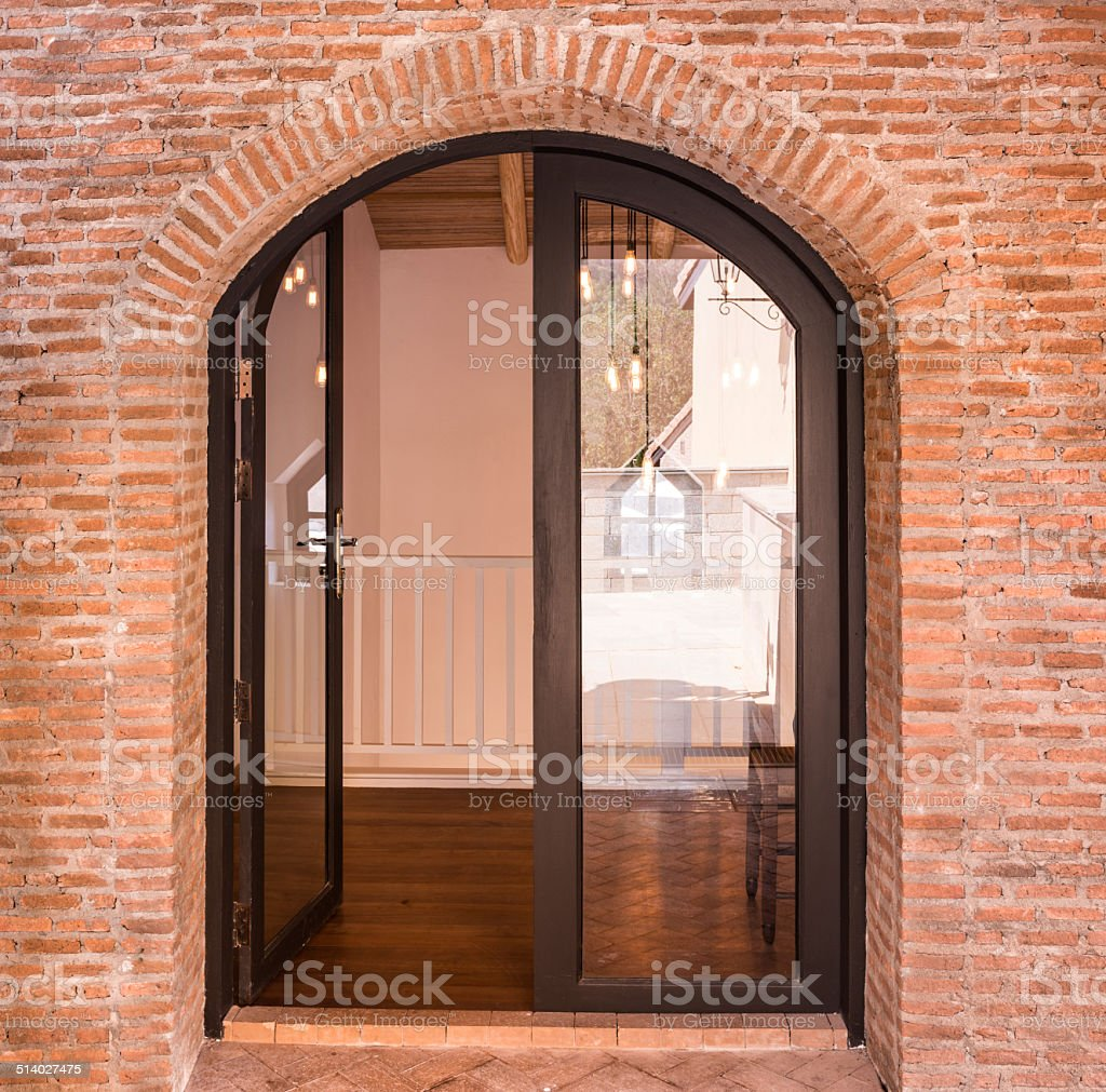 Black Arch Door On Red Brick Wall   Stock Image .