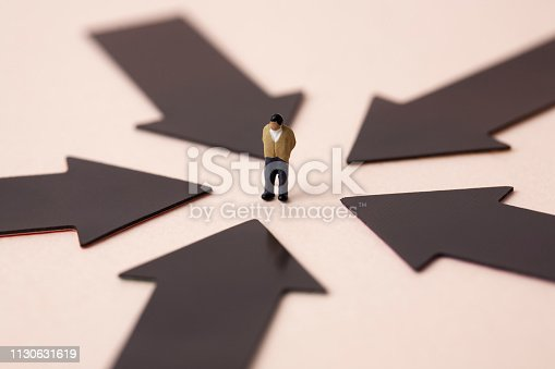 istock black arrows with miniature business man 1130631619