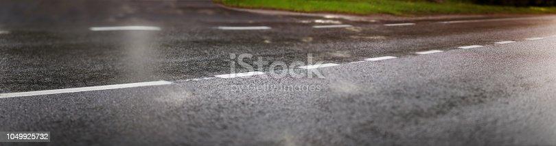 833130962 istock photo black asphalt road and white dividing lines 1049925732