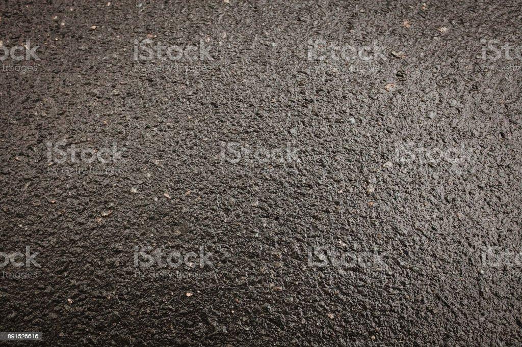 Black asphalt road with a beautiful texture. Fresh and hot asphalt....
