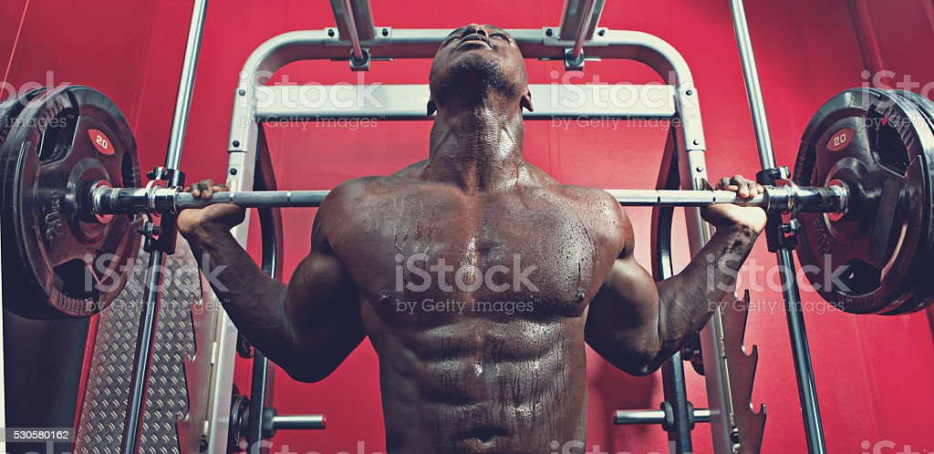 black athlete working out at a gym stock photo