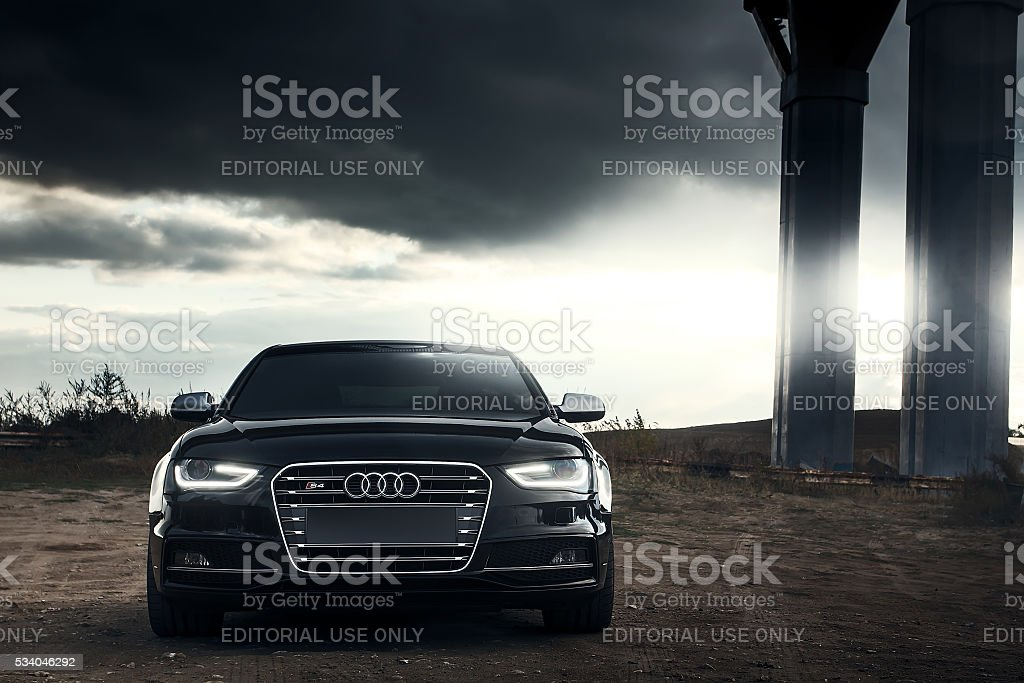 Black AUDI S4 car parked at countryside road at sunset stock photo