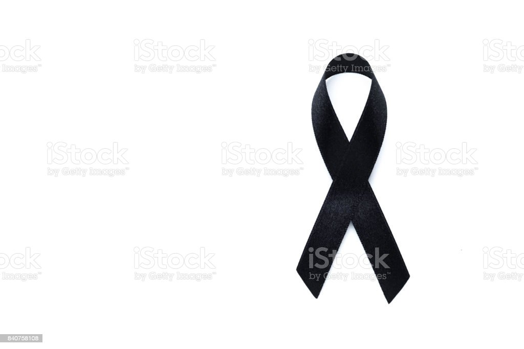 Black awareness ribbon. Melanoma and skin cancer prevention. Health and RIP concept stock photo