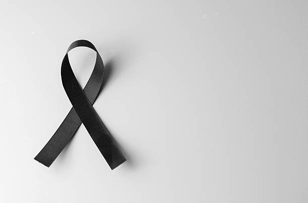 Black awareness ribbon on gray background. stock photo