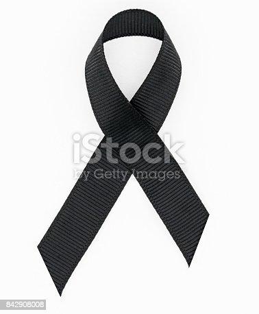 istock Black awareness ribbon on white background. 842908008