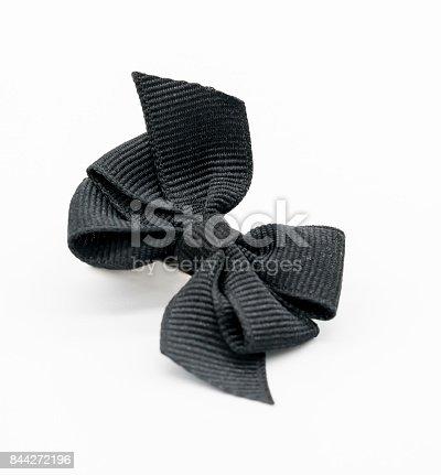 istock Black awareness ribbon on white 844272196