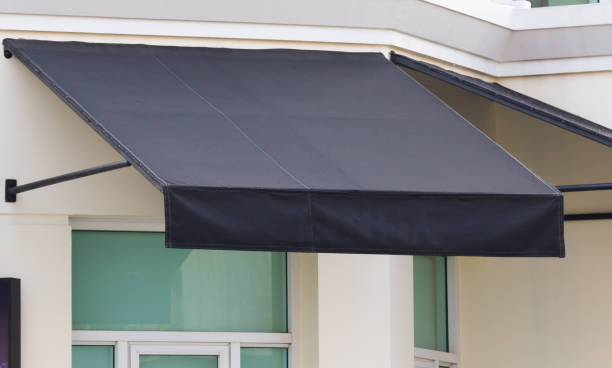 black awning and steel structure over window frame, outdoor house decoration stock photo