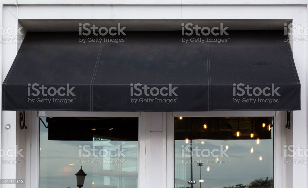 black awning over cafe windows stock photo