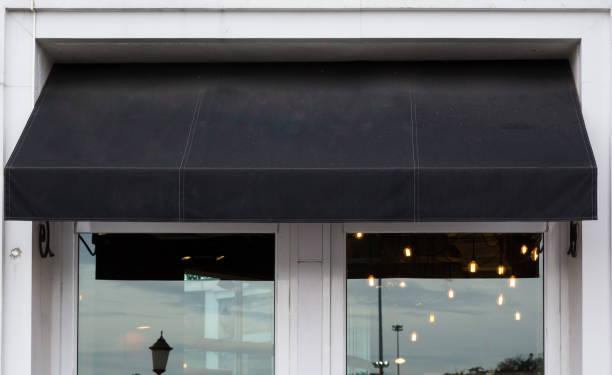 black awning over cafe windows stock photo