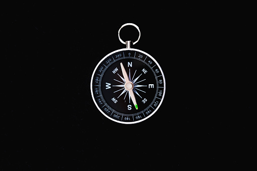 istock black background and compass 1078725016