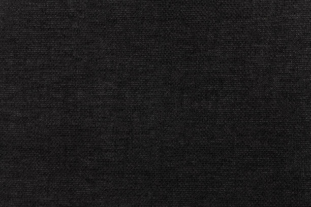 black background from textile material. fabric with natural texture. backdrop. - textile stock photos and pictures