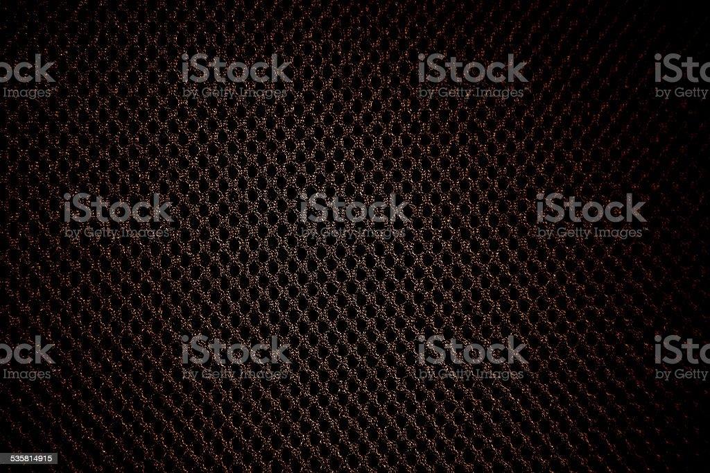 Fond noir trous spots motif en matériau textile en nylon et coton - Photo