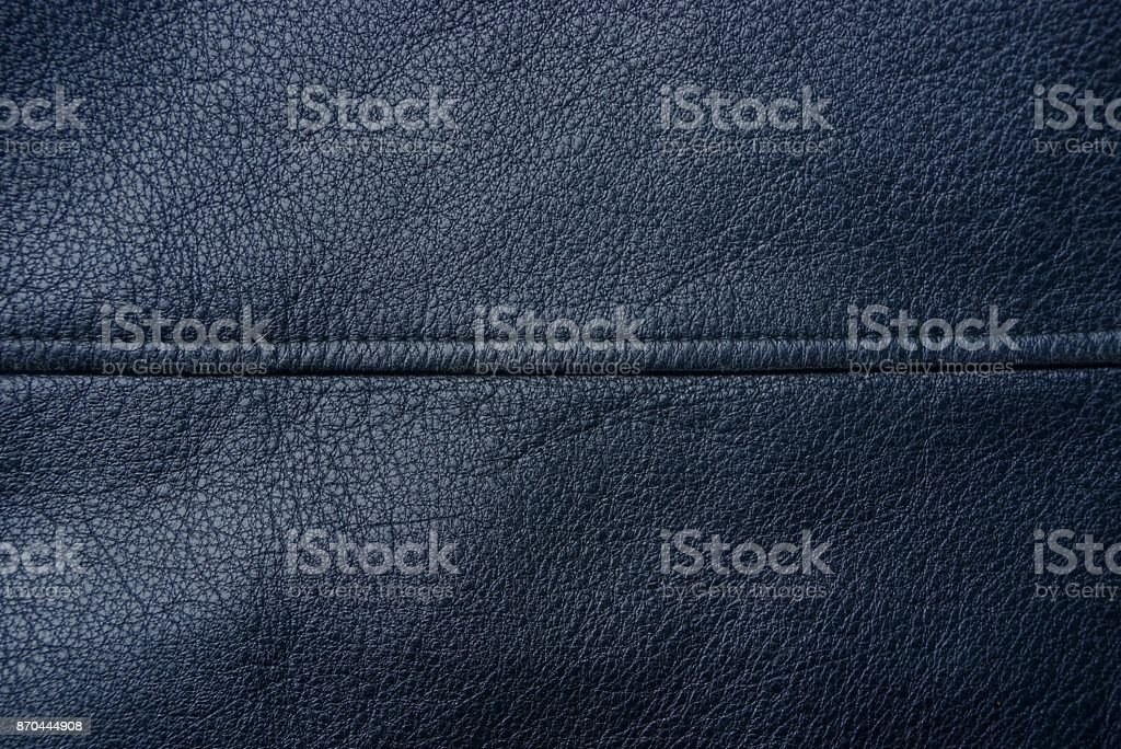 black background of a piece of leather from clothes stock photo