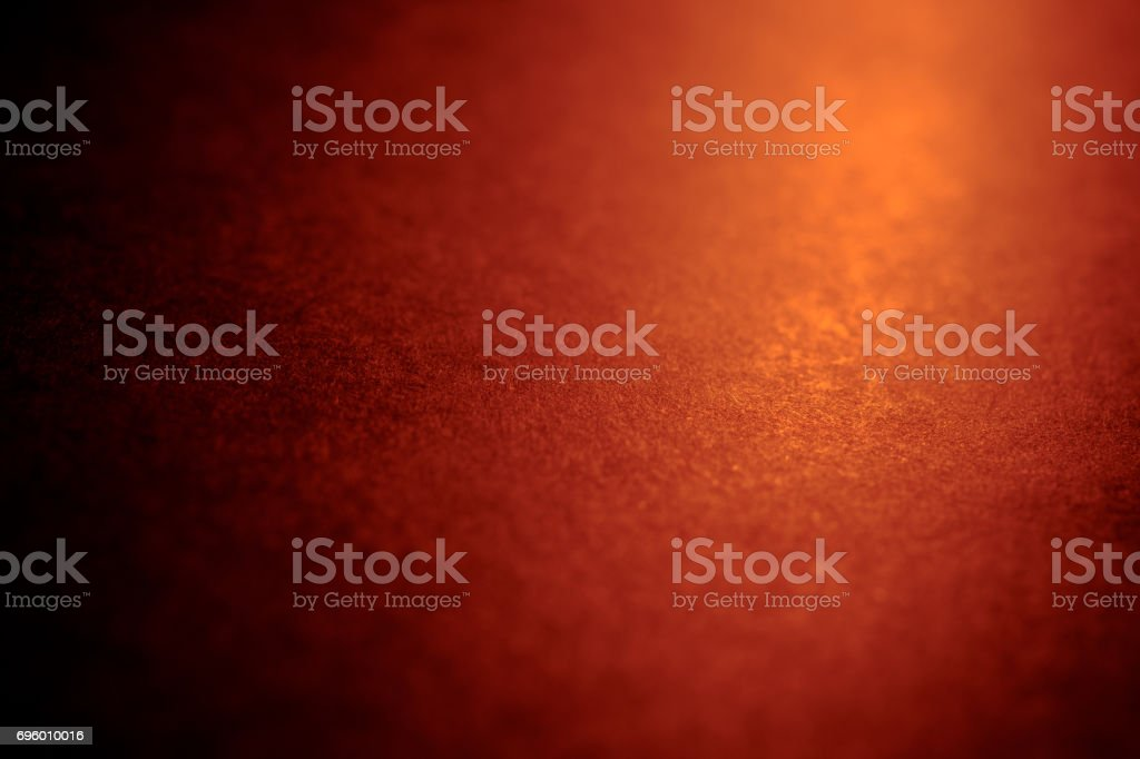 Black background texture with soft golden light from candle in night stock photo