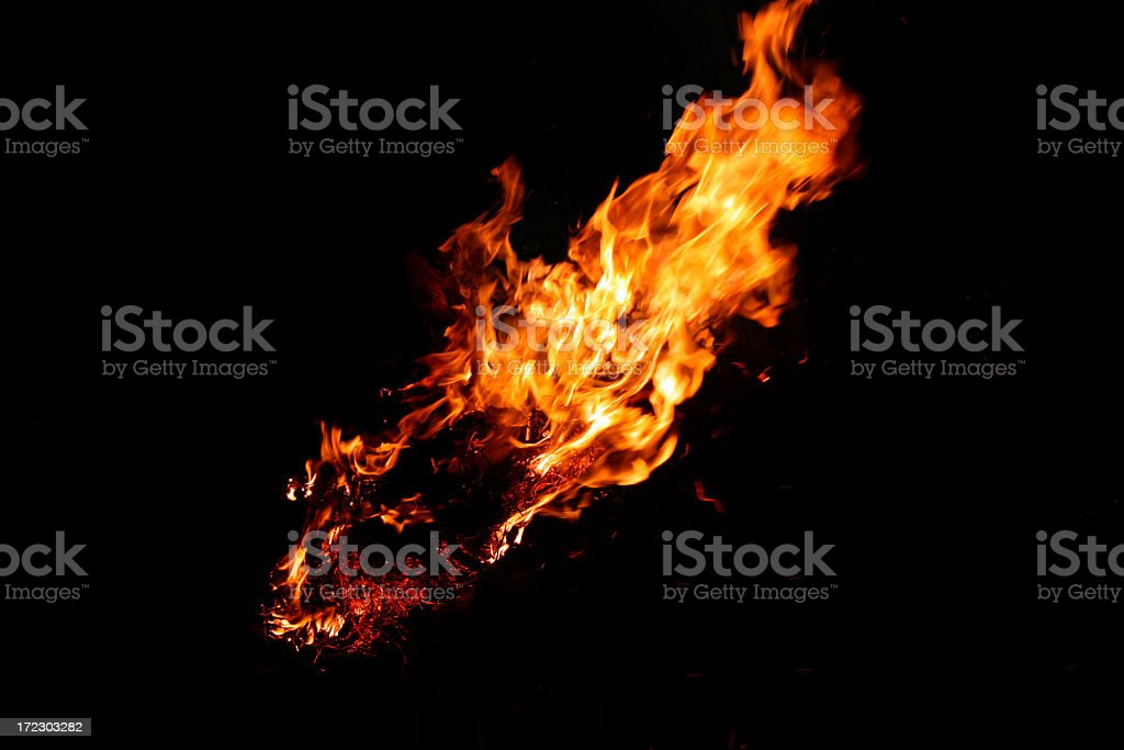 Black background with a burning flame stock photo