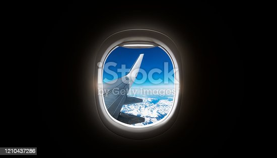 902818356 istock photo Black background with copy space with look of seat window frame of airplane flight see view of sunset clouds, airplane wing, ice mountains for luxury trip tourism travel transportation concept 1210437286
