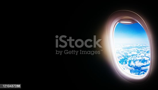 902818356 istock photo Black background with copy space with look of seat window frame of airplane flight see view of sunset clouds, airplane wing, ice mountains for luxury trip tourism travel transportation concept 1210437288
