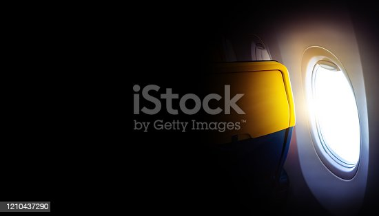 902818356 istock photo Black background with copy space with look of seat window frame of airplane flight see view of sunset clouds, airplane wing, ice mountains for luxury trip tourism travel transportation concept 1210437290