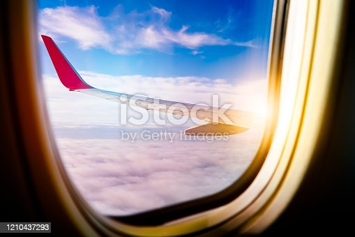 902818356 istock photo Black background with copy space with look of seat window frame of airplane flight see view of sunset clouds, airplane wing, ice mountains for luxury trip tourism travel transportation concept 1210437293