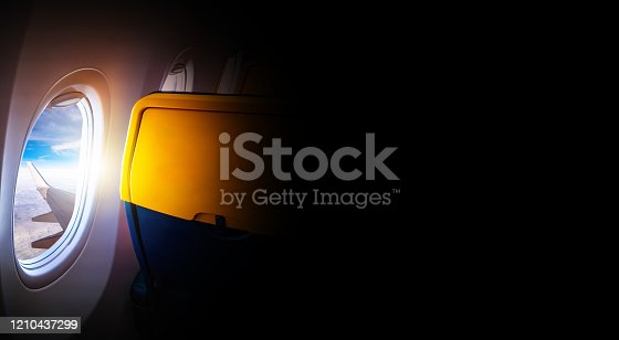 902818356 istock photo Black background with copy space with look of seat window frame of airplane flight see view of sunset clouds, airplane wing, ice mountains for luxury trip tourism travel transportation concept 1210437299