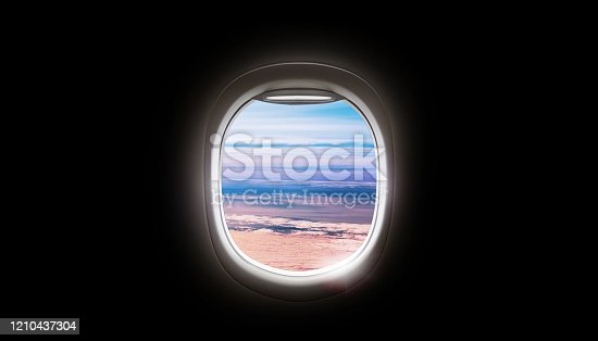 902818356 istock photo Black background with copy space with look of seat window frame of airplane flight see view of sunset clouds, airplane wing, ice mountains for luxury trip tourism travel transportation concept 1210437304