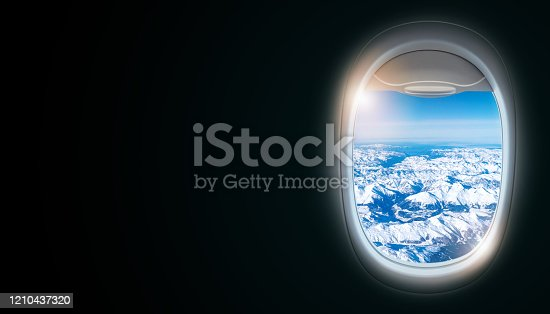 902818356 istock photo Black background with copy space with look of seat window frame of airplane flight see view of sunset clouds, airplane wing, ice mountains for luxury trip tourism travel transportation concept 1210437320